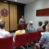 Attorney-Carmen-Bland-at-podium-discusses-the-Baker-Act-in-CCHR-Florida-headquarters
